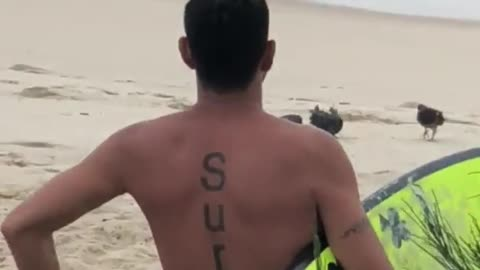 Guy highlight yellow surfboard surf tattoo on back