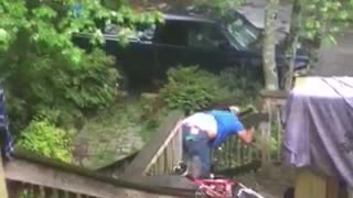 Blue shirt mountain bike down wooden steps runs into railing - Video