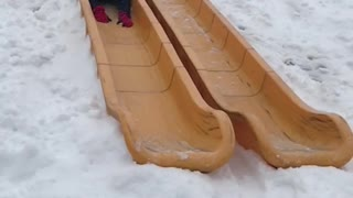 Guy black jacket falling down slide in slomo - Video