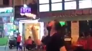 Guy blowing fire ends up burning himself - Video
