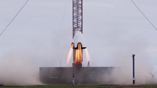 SpaceX conducts rocket hover test for astronaut capsule - Video