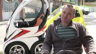 Electric mini-car to take on Sao Paulo traffic nightmare - Video