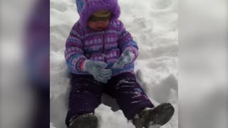 Baby Adorably Fails At Making Snow Angels