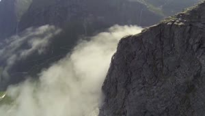 Tourists witness cliff skimming wingsuit flight - Video