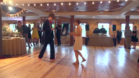 Mother and son pull off priceless wedding dance