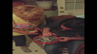 Woman receives electric shock from fly swatter - Video