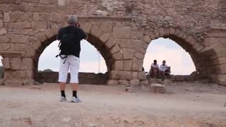 Amazing view of Israel - Photographers at Aqueducts of Caesarea, Israel - Video