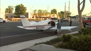 Small plane lands on California street
