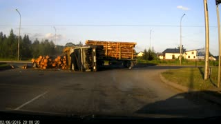 Logging Truck Loses Control and Tips Over