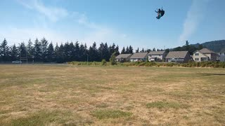 Paraglider Landing in Open field during Softball Tournament
