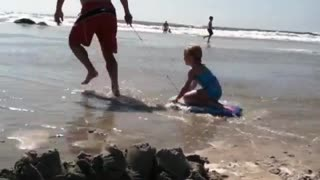 Collab copyright protection - shirtless dad pulls daughter beach - Video