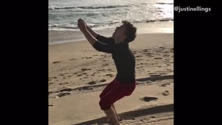 Red shorts backflip fail on beach lands on face - Video