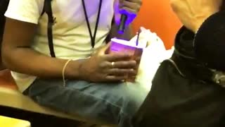 Man flashes purple light into ice cream container - Video