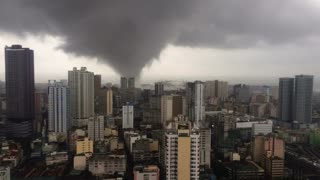 Tornado Over Buildings in Manila - Video