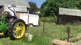 Old Farmer Destroys Neighbor's Garden With Tractor And A Shack - Video