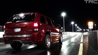 World's fastest NA SRT8 Jeep Cherokee does a wheelie! - Video