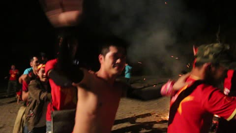 Very funny snake dance around the campfire in the forest night