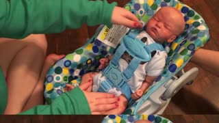 Adorable Baby Carter tries new Doll
