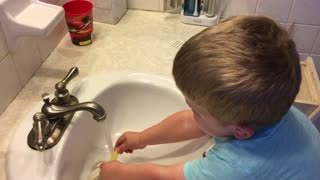 Boy Washes Cheetos In Bathroom Sink Before Eating Them - Video