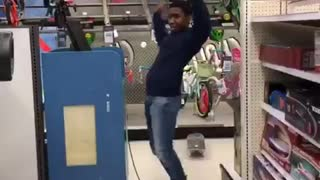 Kid rides blue skateboard in store falls on butt