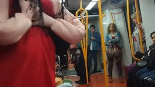 Red dress doll person dancing to music subway - Video