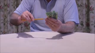 A Pencil Visibly Passes Through An Undamaged Banknote  - Video