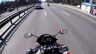 Motorcyclist Saves A Puppy On A Highway - Video