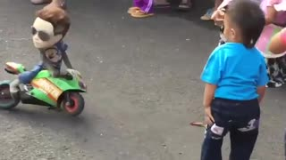 Street Entertainer monkey Driving Motor Cycle  - Video