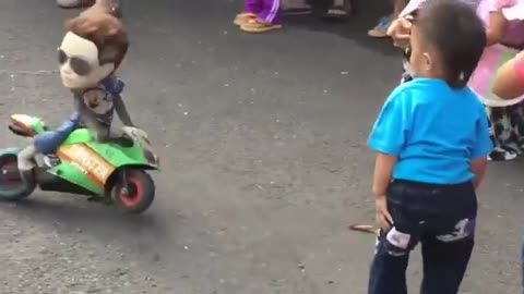 Street Entertainer monkey Driving Motor Cycle