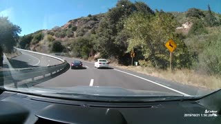 Car Overcorrects on Sweeping Highway Corner