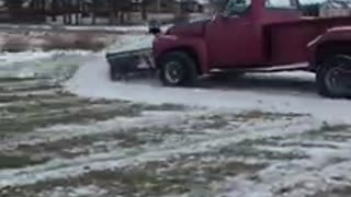 Plowing snow with a old ford truck