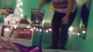 Pink shirt girl jumps off chair onto bed and falls off