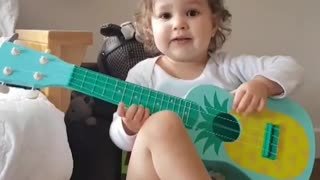 Adorable Baby Girl Hilariously Plays The Guitar - Video