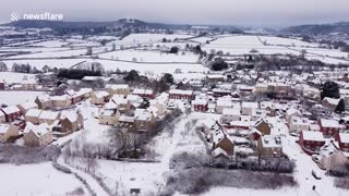 Drone footage shows beauty of English village blanketed in snow