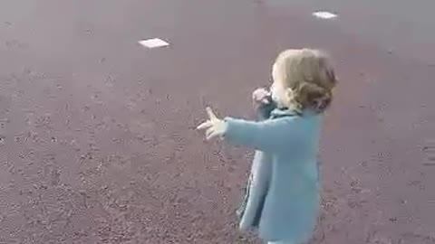 Baby girl says bye bye to Helicopter