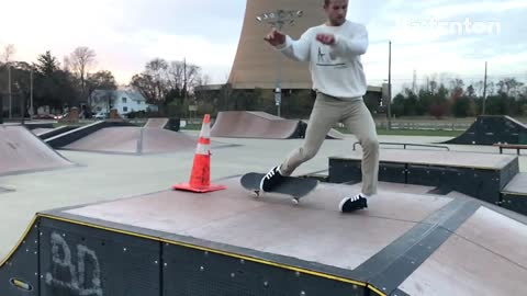 Skateboard guy jumps over traffic cone lands on ankle