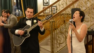 Bride And Groom Surprise Guests With Acoustic Performance - Video