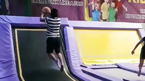 Even with trampoline hops he can't dunk. Cmon!