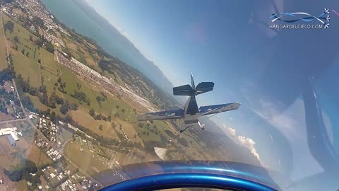 Aerobatic pilots draw giant heart in the sky