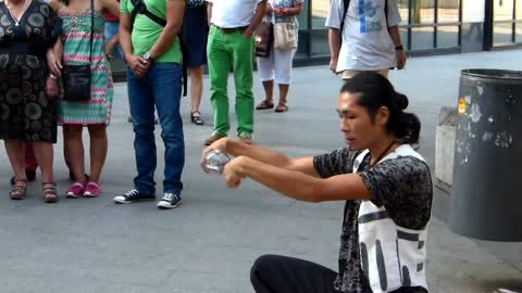 A street artist playing with a sphere of glass !