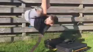 Kid in black shirt does side flip off of black platform falls on grass