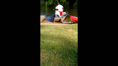 Portly Man Takes Spill Out Rowboat