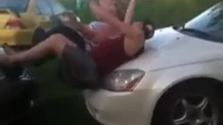 Guy jumps on car hood faceplant