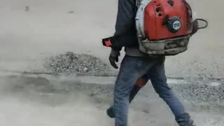 Cleaning up the street in Vietnam.  - Video