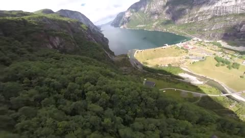 POV wingsuit BASE jump filmed in Norway