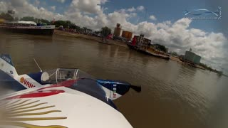 Aerobatic pilot dips plane wing into river - Video