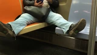 Woman on subway spreads legs across four chairs at once
