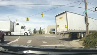 Semi Truck Crashes Taking A Hard Right - Video