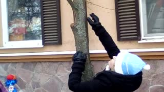 Russian Santa Rescues Kitty from Tree
