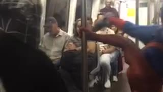 Man spiderman outfit dancing subway pole - Video